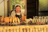 Woman selling dengaku (grilled skewers)