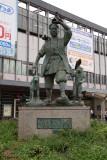 Momotarō statue outside the station