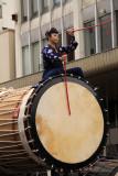Woman astride a taiko drum