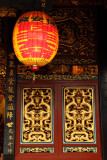 Paper lantern and ornate doors, Baoan Temple