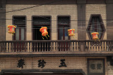 Lanterns hung outside an early 20th-century facade