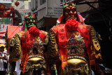 Costumed locals in a temple procession