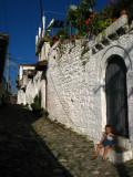 Boy sitting outside a house in Gorica