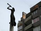 Herald statue and crumbling apartment block
