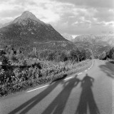 Our shadows on the road at Lofoten Islands