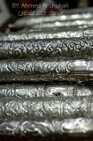 A scroll holder made of silver