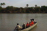 Crossing river within hippos...