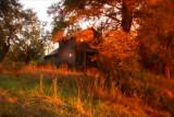 Brilliant sunset. Abandoned house.
