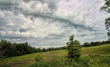 Sloping Field and Clouds