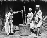 Family with pestles at giant mortar