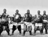 1909 - Strongmen In traditional dress