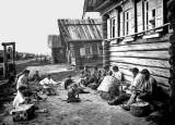 c. 1905 - Men and boys, outside their homes, making baskets