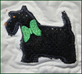Scotty dog applique on dotted sequin fabric..jpg