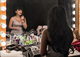 Mignonette Applying Makeup