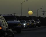 The sun, shrouded by Saharan dust, sets over central Texas