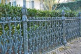 Mansion with the handcrafted Iron Corn Row Fence in the Garden District of New Orleans