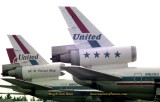 1976 - the difference in the tails of United Airlines DC10-10's N1816U and N1826U parked at Miami International Airport