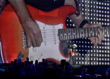 Brad Paisley plays in front of his huge big screen