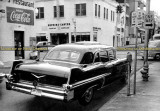 1957 Cadillac Fleetwood Seventy-Five Limo with Hopkins-Carter Marine Supply in the background