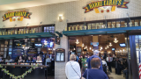 May 2016 - Karen waiting with me for seating at Harry Caray's Seventh Inning Stretch restaurant at Chicago Midway Airport