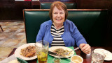 February 2017 - Karen dining on a late lunch of great churrasco, plantains and rice at Molina's Ranch Restaurant in Hialeah
