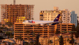 2016 - closeup version of FedEx Boeing B777F on short final approach to SAN at sunset