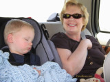 July 2007 - our sleeping grandson Kyler and grandma Karen in the back seat of a car