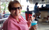 August 2010 - Karen having a rare alcoholic beverage at one of the outdoor bars at the Hale Koa Hotel, a military resort