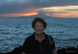 August 2010 - Karen with the sunset and Lanai behind her at the Marriott Wailea Beach Resort on Maui