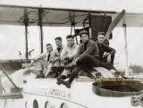 1920-1924 - Three Aeromarine Airways Miami-based pilots and two mechanics sitting on Aeromarine's converted Model 75
