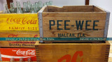 An old case of Pee Wee sodas that were brewed in and distributed from Hialeah on display at the Burger Museum in Miami