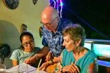 CUBA_3551 Myo, Ben, Susan checking the menu at Casa Prado
