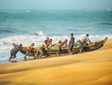 Fishermen Retrieving their Boat