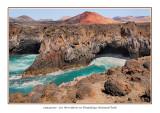 Spain - Lanzarote - Timanfaya National Park - Los Hervideros with Montanas del Fuego