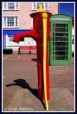 Ireland - Co.Cork - Kinsale - Colourful old pump and telephone box.