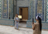 Posing with art at Shah-i-Zinda, Samarkand