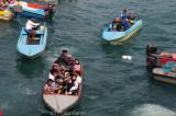Morning commuters from Pulau Gaya (Gaya Island) reach Kota Kinabalu