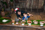 Dusun woman welcomes a young Australian visitor