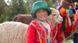 Girl posing with a llama for tips