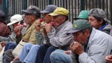 Men enjoying ice cream in front of Iglesia de la Compania