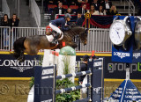 Kent Farrington on Voyeur soaring to a first place win at the Longines FEI World Cup Show Jumping competition jump off at the Ro