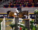 Andrew Kocher riding Quarto Mail over oxer at the McKee Family International Jumper Competition at the Royal Horse Show Ricoh Co