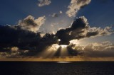 Crepuscular rays breaking the clouds