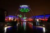 Tomorrowland entrance, rainy night