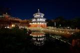 China temple and reflective pool at night