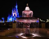 Fountain and castle background at night