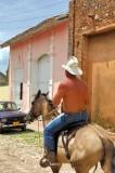 Topless Cowboy Admiring The Russian LADA Car of His Dreams