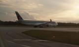 Qatar Airways A350-941 in the setting sun
