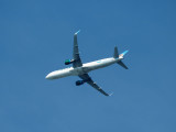 Frontier Airlines aircraft over Forest Park, St. Louis