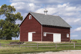 It is hard to find a well kept old barn. Today's machinery is just so much bigger than a team of horses or mules.  An image may be purchased at http://edward-peterson.pixels.com/featured/red-barn-on-a-cloudy-day-edward-peterson.html?newartwork=true